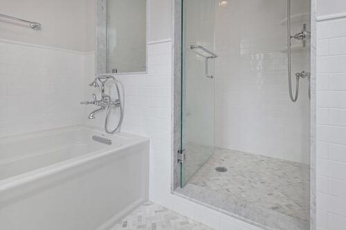 His & hers luxury master bath suite with marble accents