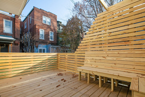 Elevated patio deck with custom built-in benches