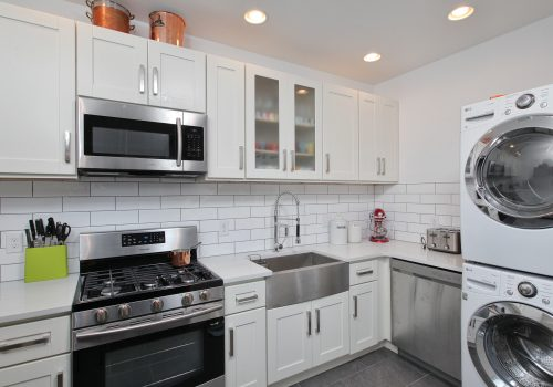 Efficient and compact deign-build inspired 50 square-foot kitchen complete with laundry