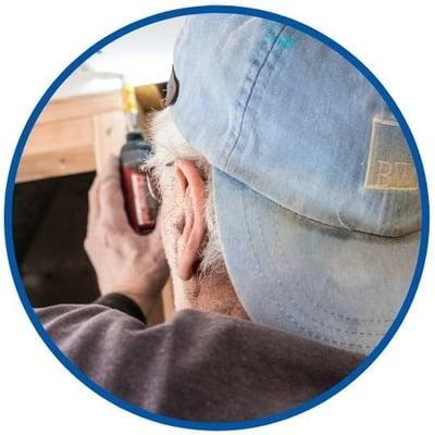 Bellweather Design Build carpenter in light blue ball cap working on home in Philadelphia