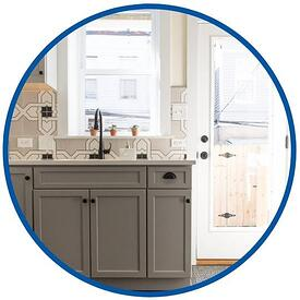 photo of grey cabinets and black sink in philadelphia taken by Bellweather Design Build