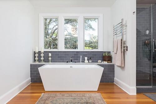 Contemporary design-build master bath with a free-standing soaking tub
