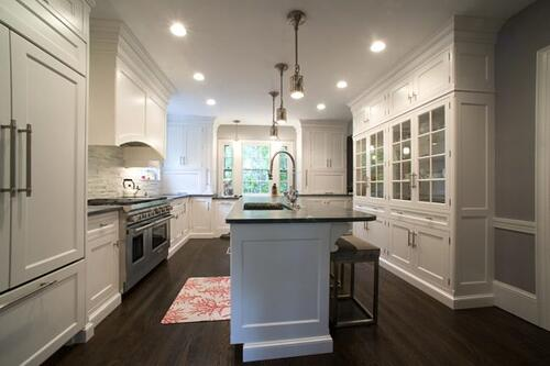 Luxury kitchen with custom cabinetry and built-in appliances.