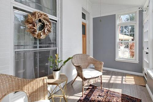 Relaxing sunny porch renovation complete with lofted ceiling