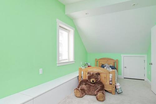 A playful kids' bedroom is created from an attic conversion