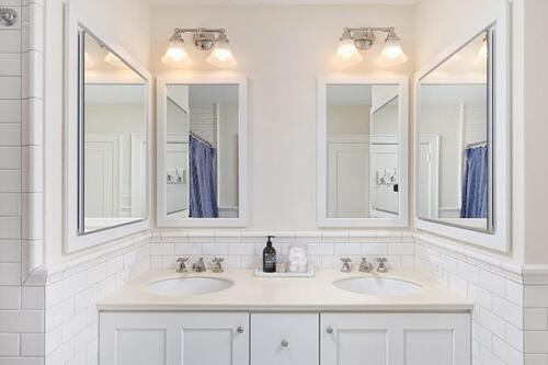 Traditional master bath with period style