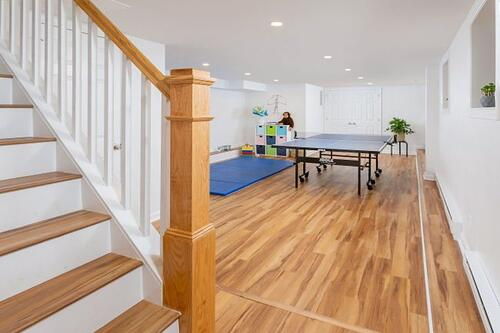 Basement gym transformation developed through design-build with full bath and laundry