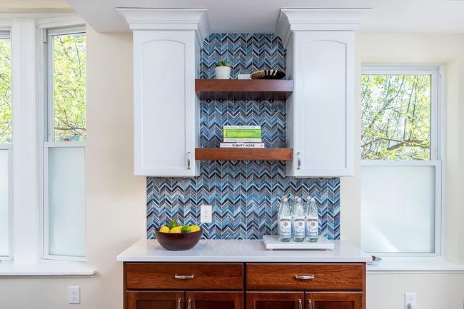 Bold blue-patterned backsplash in remodeled traditional kitchen by Bellweather Design Build in Philadelphia