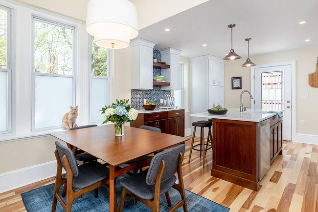 Bright kitchen remodel with wooden table sitting area in Philly by Bellweather Design-Build