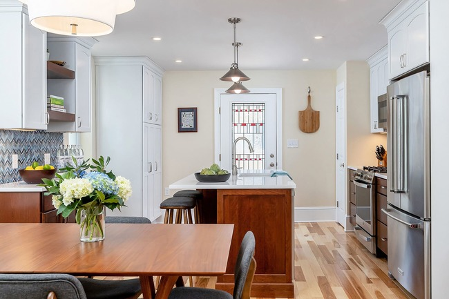 Beautifully remodeled traditional kitchen with wooden table dining area by Bellweather Design-Build in Philly