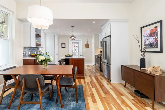 Traditional kitchen and dining room remodel with brown wooden dining table by Bellweather Design Build in Philadelphia