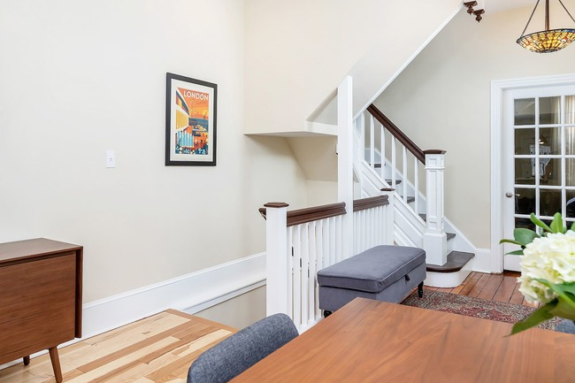 Remodeled wooden stairway with storage bench by Bellweather Design-Build in Philadelphia