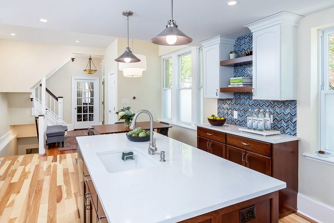 Traditional kitchen remodel with blue textured backsplash and island with built-in sink by Bellweather Design-Build in Philadelphia
