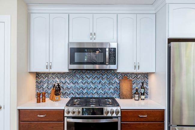 Oven and glass chevron backsplash tile in transitional kitchen remodel by Bellweather Design-Build in Philly