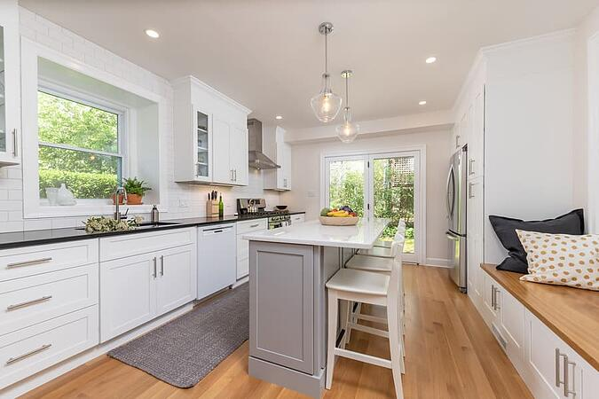 Mount Airy transitional kitchen with white island and two bar chairs by Bellweather Design-Build