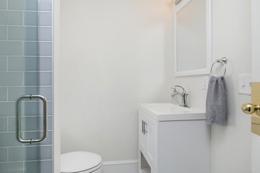 Small Sink and Toilet Next to Shower