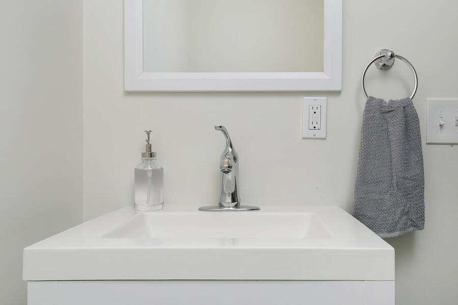 Smaller White Sink with Small Mirror Above
