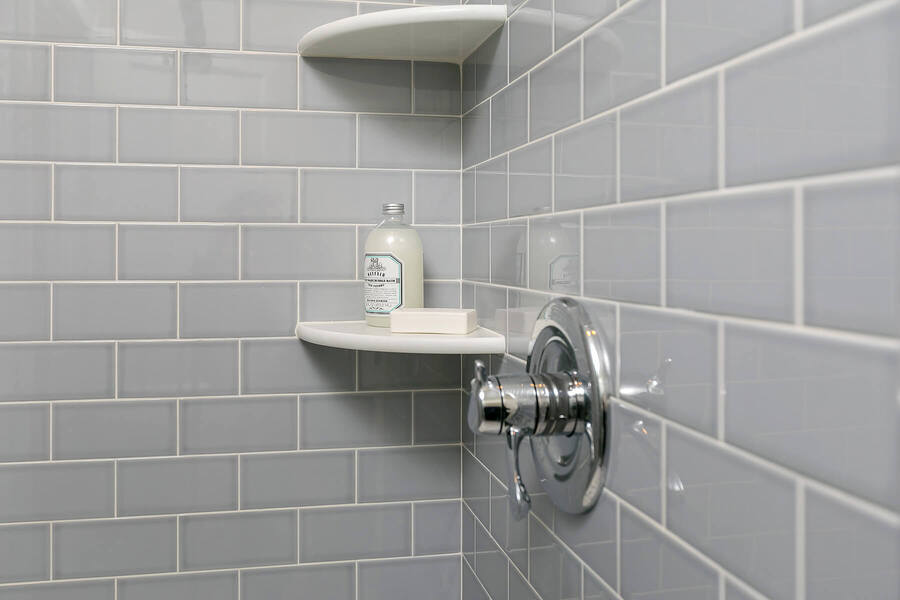 Shelves Inside Shower with Product on Them