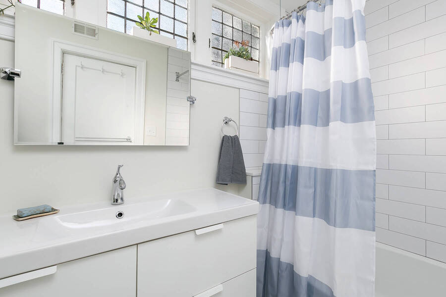 Sink and Striped Shower Curtain