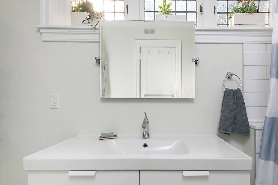 White Sink with Small Mirror Above