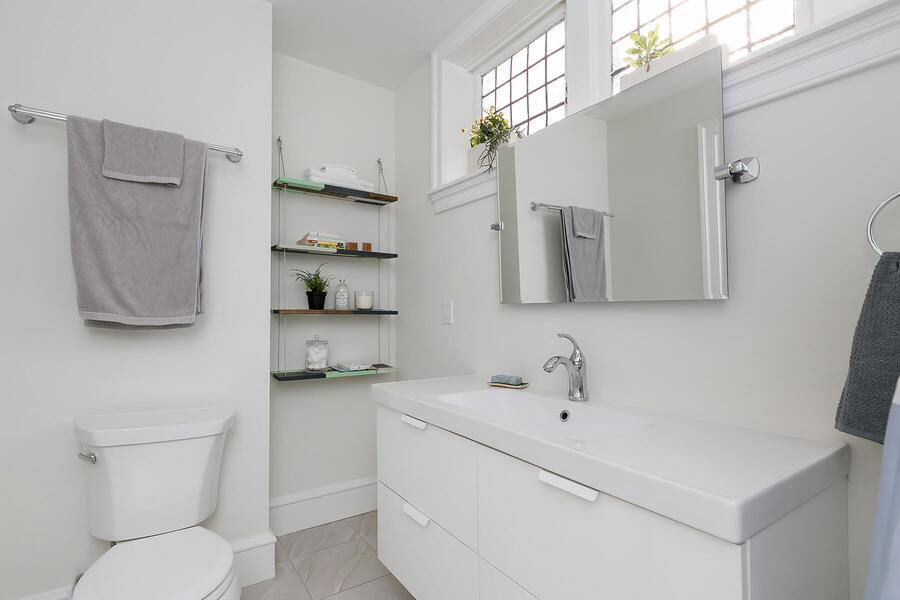 Sink and Mirror with Toilet Next to It