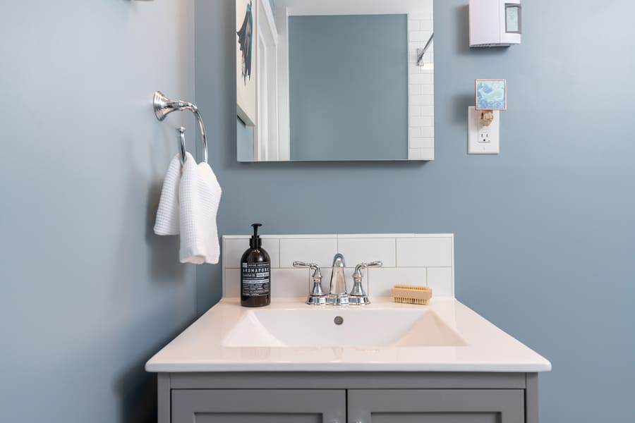 Bathroom Sink Featuring Soap and a Stainless Steel Faucet