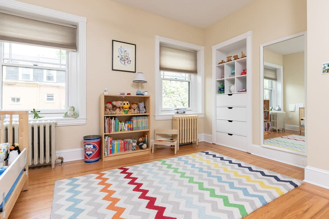 Philadelphia kids room with small zig-zag rug and light hardwood floors by Bellweather Design-Build