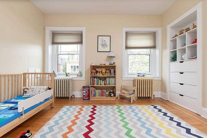 Traditional style kids room with book shelves and stuffed animals with hardwood floor by Bellweather Design-Build in University City
