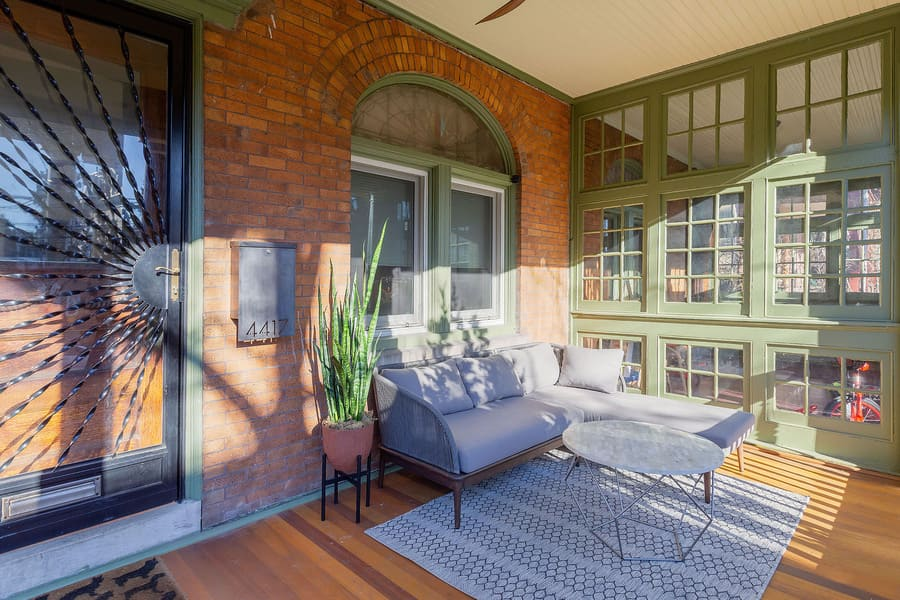 Historic front porch restoration with brick walls and green window panes by Bellweather Design-Build in Squirrel Hill