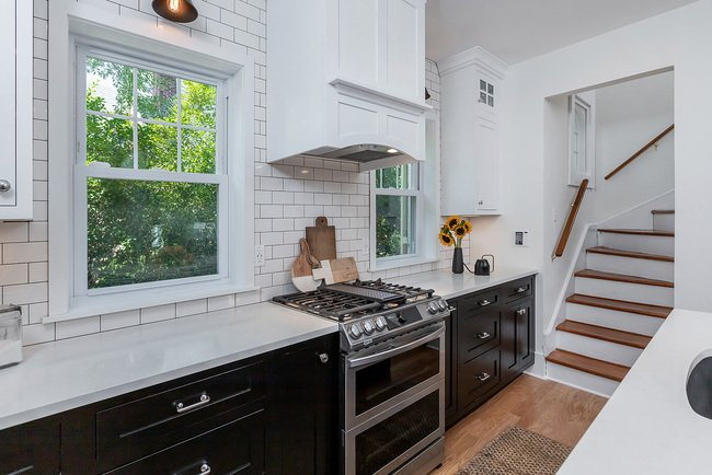 Stainless Steel Stove Next to Window and Stairs