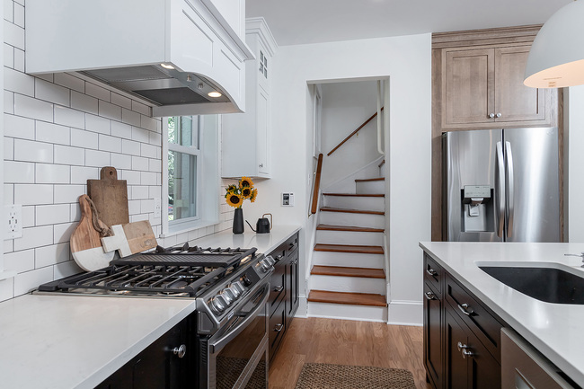 Stainless Steel Stove Next to Stairs