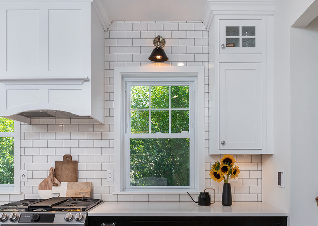 Window Above White Counter and Flowers