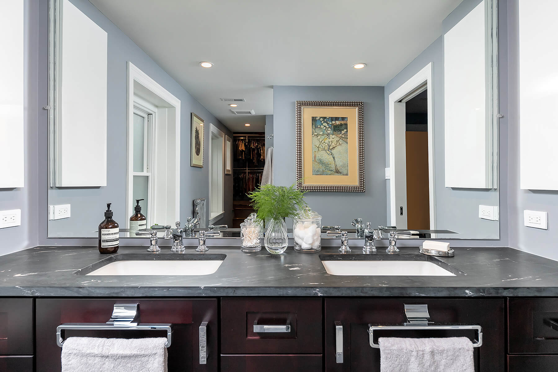 Dark Wood Sink with Large Mirror Above the Gray Counter