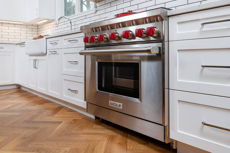 Large stove in kitchen remodel in the Main Line by Bellweather Design-Build