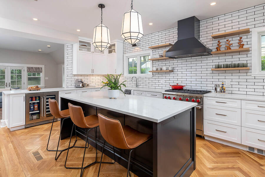 Main Line kitchen remodel with transitional large island with brown seating by Bellweather Design-Build