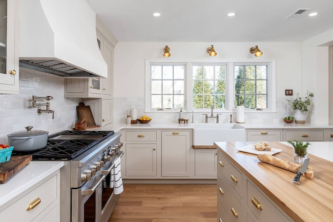 bright and airy spacious kitchen tucked within a traditional brick Colonial home in Wynnewood, Pennsylvania