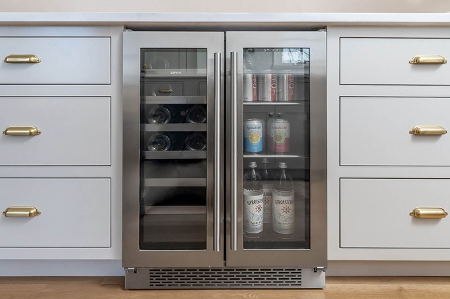 bright spacious fridge tucked within a traditional brick Colonial home in Wynnewood, Pennsylvania by Bellweather Design Build