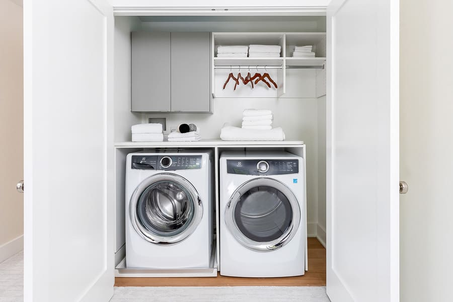 Washer and dryer in closet in hallway of Philadelphia home by Bellweather Design-Build