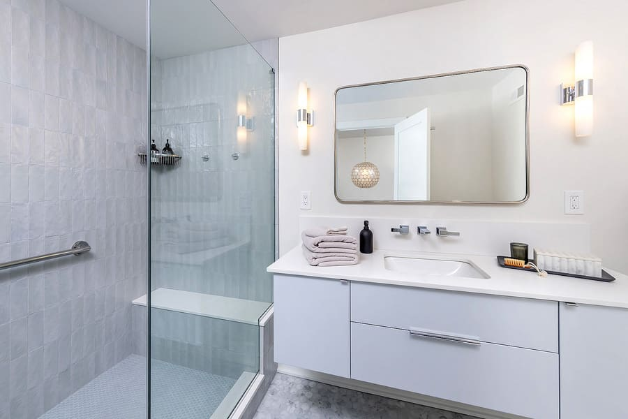 White transitional bathroom vanity with walk-in shower by Bellweather Design-Build in Philadelphia