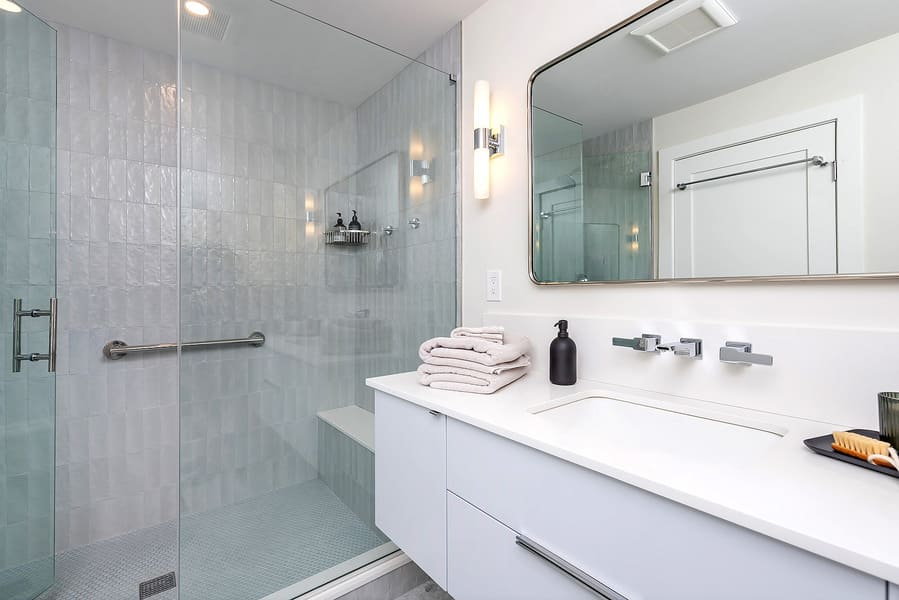 White transitional bathroom with white vanity and walk-in shower by Bellweather Design-Build in Philly
