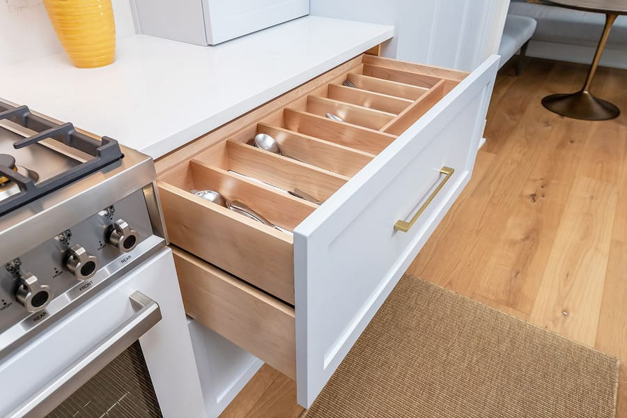White wooden drawer in transitional kitchen with separate wood sections for silverware by Bellweather Design-Build in Philly