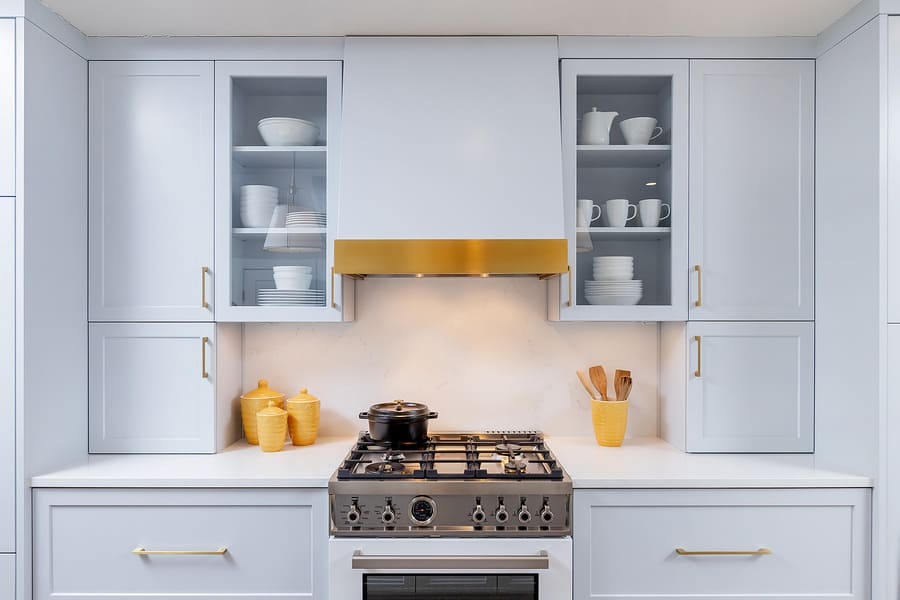 White cabinets around black stainless steel stove in Philly transitional kitchen by Bellweather Design-Build
