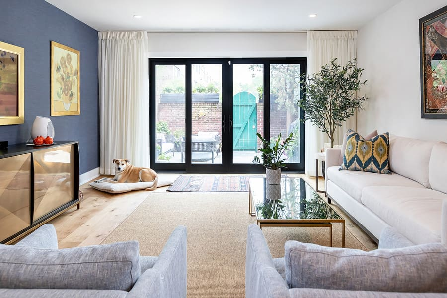 Transitional living room with blue accent walla and black accents by Bellweather Design-Build in Philadelphia
