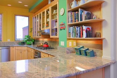 Whimsical custom kitchen including custom cabinetry and open shelving