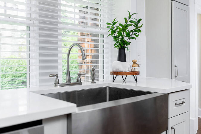 Stainless Steel Sink with White Counters