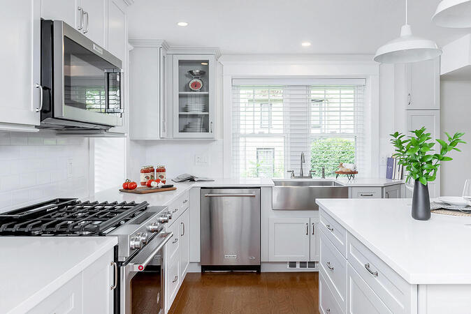 White Kitchen with Gray Cabinets and Wood Floors