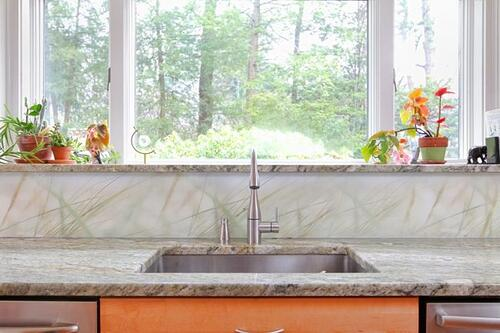 Modern kitchen and bath renovation was with semi-custom solid solid wood cabinets and artist's design elements