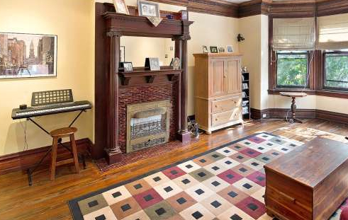 gas hearth with original mantle surround and wood molding