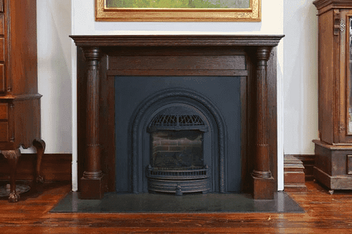 Historic gas hearth restoration fireplaces with restored architectural salvaged hardwood mantles