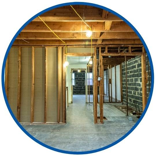 photo of basement remodel with brick walls completed by Bellweather Design Build in Philadelphia